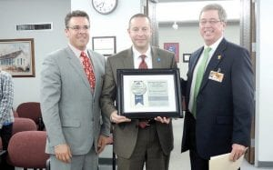 Region 5 President Timothy Stein and representative Eric Lieske present the Regional Superintendent of the Year Award to C-A Superintendent Steve Tunnicliff.