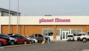 """NEW YEAR, NEW YOU — Make 2015 the year to keep your resolution to get fit and healthy. Coming to help in the new year is a Planet Fitness health club at Genesee Valley Center mall. A brand new exterior entrance has been created on the south side of the mall, accessible from the parking lot between Burlington and Macy's. Equipment is being moved in but mall officials say the opening date is not yet set. Planet Fitness is known for its affordable prices. Planet F also started the new year off right as the official fitness sponsor of the Times Square New Year's Eve celebration in New York and was featured on the """"Dick Clark's New Year's Rockin' Eve with Ryan Seacrest 2015,"""" according to a corporate press release."""