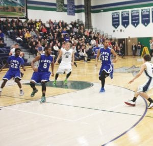 Carman-Ainsworth played three of its first four games this season on the road, including this Dec. 12 contest at Lapeer, where good defense by Josh Jackson (22), Jaylen Bradley (5) and Isaac Gillum (32) helped the Cavaliers to a 33-32 win. The Cavs were back home this week for Tuesday night's game against Swartz Creek and Friday's game against Saginaw.