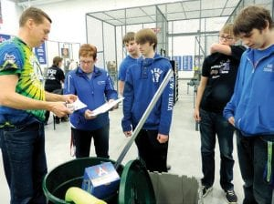 A pool noodle, recycling can and storage bins are among the supplies needed for the 2015 FIRST Robotics challenge. Big Mo, the CAHS team, met at the FRC kickoff Saturday to get their kit and, like their peers, gathered in a separate classroom to begin strategizing their robot build.