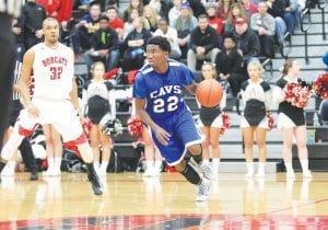 Carman-Ainsworth's Josh Jackson handles the ball in a game earlier this season.