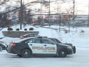 Township patrol cars respond to recent problem at the Corunna Road Walmart.