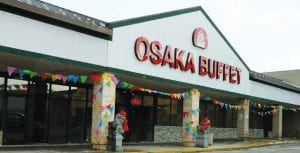 A colorful pennant banner is draped across the front of Osaka Buffet to let diners know it is now open for business.