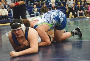 Grayden Hamilton looks to regain control against a league opponent for the Cavaliers at 285.