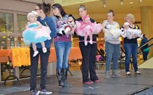 Baby girls under age one drew the most competitors. All were dolled up in their Sunday best with adorable headgear.