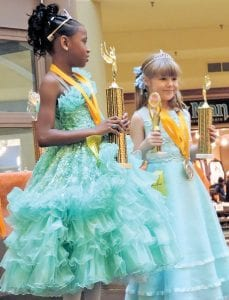 )These two little princesses both captured trophies in the Little Miss 7-10 year old competition.