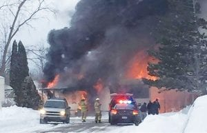 Flames and thick, black smoke roll off a mobile home in Estates of Genesee Valley. The occupants, who lost everything, had just moved in and had yet to purchase insurance.