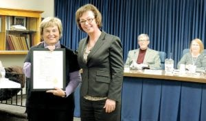 Township Supervisor Karyn Miller (right) presented a board-approved proclamation to recently retired school board member Peggy Anderson.