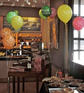 Cheerful balloons and a spread of free pastries greeted guests attending Panera's grand opening celebration last weekend.