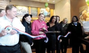 Panera store and district managers joint Flint Township officials and Flint & Genesee Chamber of Commerce representatives for the official ribbon cutting to welcome the Miller Road shop.
