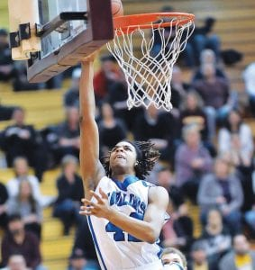 Carman-Ainsworth's Juwan Willis goes up for a layup in last Friday's district final at Davison.