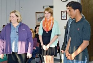 Vera Hazlett, English teacher and spelling bee organizer, presented three of the top school finishers at the school board meeting last week. They are Jodi Arnold, 12th grade, Hamza Jafari, 10th grade and Jaylyn Nichols, 9th grade. Hamza also won the 10th grade bee at the county level and competed for the overall championship trophy.