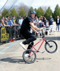 Trevor Meyer, a three-time X Games Gold Medalist, is a professional BMX flatland athlete who tours the country demonstrating his gravity defying skills including handlebar riding. Several well-known professional skateboarders and BMX riders performed vertical feats on a half-pipe ramp set up in the parking lot at CAHS.