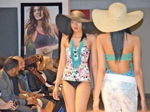 From left, beach attire was one of the featured scenes in Macy's fashion show. Several male models also walked the runway in the latest men's styles. A plus-sized model and fashions were featured in the show.