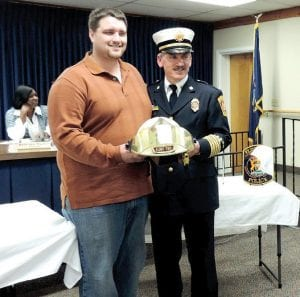Fire Chief John Ringwelski received an official retirement sendoff from the board including a proclamation, cake and the presentation of his helmet.