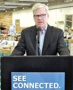 Michael MacDonald, CEO of the national shoe chain, grew up in Flint and made a special appearance at the opening of his hometown store.