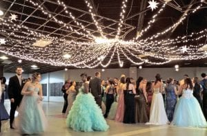 "Sparkly lights strung from the ceiling helped to create the ""Night Under the Stars"" prom theme."