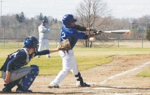 Jawanza Edwards swings the bat for the Carman-Ainsworth varsity baseball squad.