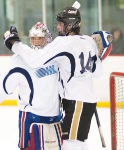 Flint Firebird Brenden Rons (14) congratulates one of three goalies during the Blue and White scrimmage on Sunday.
