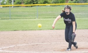 Carman-Ainsworth's Madison Cox releases the final pitch in the 16-1 mercy-ruled loss to Lapeer on Monday at Lapeer.