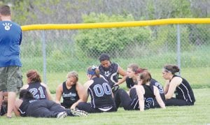 The looks on their faces say it all after the Carman-Ainsworth softball team lost 10-0, 16-1 against Lapeer at Lapeer on Monday. Lapeer clinched the Saginaw Valley League title with the win.
