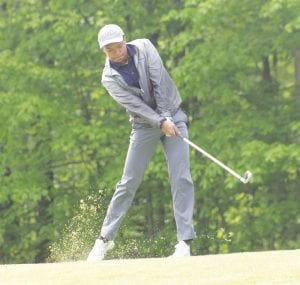 Carman-Ainsworth senior Haywood Petty swings from the fairway during last Thursday's Div. 1 district at Davison Country Club. Petty shot 79 to qualify as an individual for this week's regional.