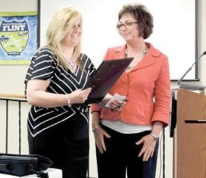 Supervisor Karyn Miller reads a proclamation honoring assessor Nermina Vidovic, who is resigning to move to Florida. A traditional parting cake and coffee reception was held to honor Vidovic.