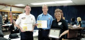 Assistant Chief Mike Burkley and Captain Loren Colbert received awards from the Red Cross for a fire safety campaign and in turn presented a certificate of appreciation to Annette Swain, a Red Cross volunteer coordinator.