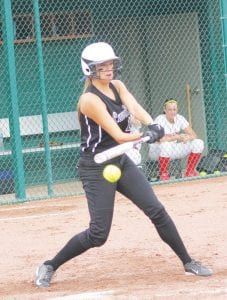Carman-Ainsworth's Jessica Smith gets the bat on the ball during the semifinal loss to Swartz Creek.