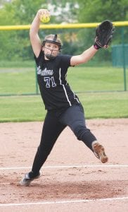 Carman-Ainsworth's Madison Cox goes through her pitching motion during the semifinal loss to Swartz Creek.
