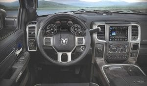 The cockpit of the 2016 Ram 2500 Heavy Duty Laramie Limited.