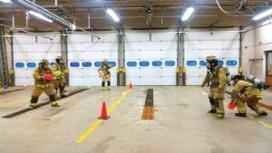 Township firefighters in full gear played dodgeball to practice air management during a recent training exercise.