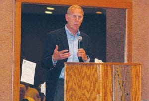 Michigan men's' basketball head coach John Beilein speaks to the crowd at Atlas Valley Country Club last Tuesday.
