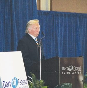 IMS Hockey owner Rolf Nilsen addresses the 100-plus attendees and media at the press conference last Thursday to unveil the new name of Perani Arena – Dort Federal Credit Union Event Center.