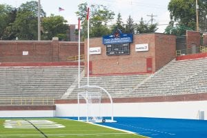 New field turf, goal posts and soccer nets have been installed at Atwood Stadium as a sign commemorating Mark Ingram's Heisman Trophy sits atop the secondary scoreboard.