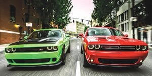 2015 Dodge Challenger SRT with the HEMI® Hellcat engine (left) and 2015 Dodge Challenger SXT Plus (right)