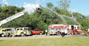 Fire trucks displayed their water hose capabilities, giving anyone standing to close an impromptu shower. National Night Out activities were held at the Flint Township Police Department in partnership with the Swartz Creek and Mundy Township police and fire departments.