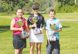 Left to right, Abby Schell, Jolie Brochu and Nicholas Kurtiak display their trophies as girls' 5-hole, girls' 9-hole and boys' 5-hole champions, respectively.