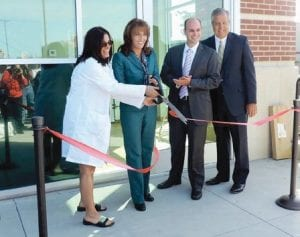 Melany Gavulic, president and CEO of Hurley Medical Center performed ribbon-cutting honors, assisted y Ridgway White, president of the C.S. Mott Foundation; Tim Herman, president and CEO of the Flint & Genesee Chamber of Commerce and Mona Hanna-Attisha, director Hurley Pediatric Residency Program.