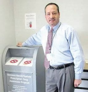 John Joseph, Baker College of Flint campus safety director, with the pill collection box.