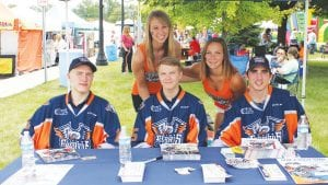Hakom Nilsen, Vili Sarrijarvi and Alex Nedeljkovic (left to right) of the Flint Firebirds pose with Lapeer's Erica Miller and Emily Dahuron of Ann Arbor from the Lady Firebirds public relations team last weekend at Lapeer Days.