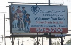 Repeating last year's public school opening notice, C-A officials have placed a billboard on Corunna Road just east of Dutcher Road.