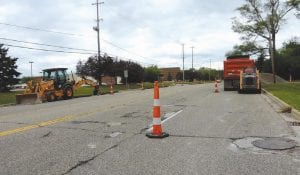 Last week, road crews started resurfacing work on Lennon Road in front of the Post Office, one of several late-summer projects in the township.