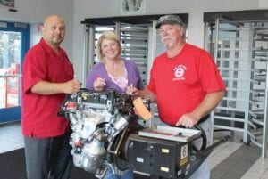 Flint Engine Operations recently built its one millionth and final 1.4-liter turbo engine. Signed by employees, it will be displayed at Flint Engine. Pictured (L to R) are UAW Local 599 President Dan Reyes, Plant Manager Terri Burden and UAW Local 599 Chairman Dave Aiken.