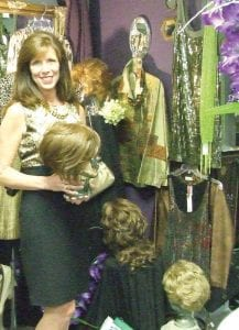 Debra Ann Meek, owner of Mirror Image Consignment, shows some of the wigs available at her shop for medical patients who have lost their own hair due to illness or treatment.