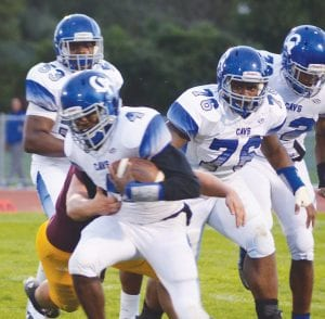Carman-Ainsworth quarterback Josh Jackson (4) ran for three touchdowns in last Friday's 35-18 win at Flint Northwestern.