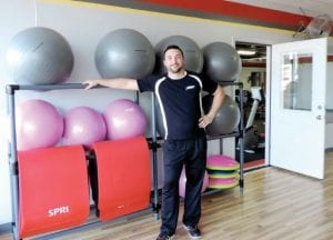 Tony Zerka, manager of Snap Fitness, shows off new aerobic studio.