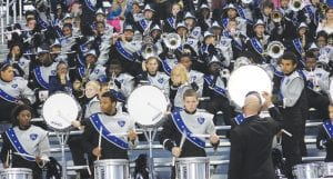 The Carman-Ainsworth band strikes up the school fight song after another Cavs' touchdown in Friday's game.