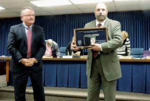 Police Chief George Sippert presented retirement badge and weapon to Officer Vern Chontos at the township board meeting Monday night.
