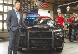 Tim Kuniskis, President and CEO - Dodge and SRT Brands and Vice President - Fleet Operations, FCA North America, with the 2016 Dodge Charger Pursuit.
